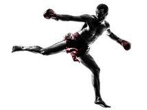 One man exercising thai boxing silhouette. One caucasian man exercising thai boxing in silhouette studio on white background Stock Photo