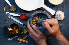 Free One Man Grinding Spices Royalty Free Stock Photo - 85141025