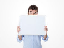 One man with half face cover by an empty board watching somethin Royalty Free Stock Image