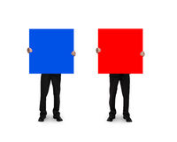 One man holding blue board another holding red board Stock Photography