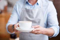 One man holding hot drink Stock Photography