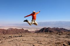 One man jump for joy. stock images