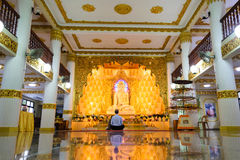One man meditating in a Buddhist temple in Singapore. Royalty Free Stock Photo