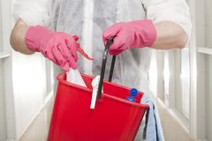 This one. Man in Overall Picking Spray from Red Bucket royalty free stock images