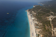 One man is parasailing over the blue sea in Lefkada, Greece Stock Photos