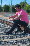 One man in pink on train tracks Stock Photos