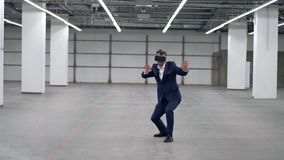 One man playing in office room, wearing VR glasses. 4K stock footage