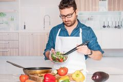 One man portrait making a vegan lunch stock photography