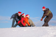 One man pull two girls on sled Royalty Free Stock Photography