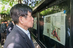 One man reading newspaper fuxing park shanghai china Royalty Free Stock Image