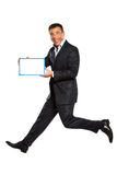 One man running jumping holding whiteboard Royalty Free Stock Image