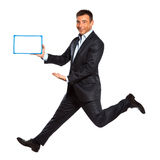 One man running jumping holding whiteboard Royalty Free Stock Photos