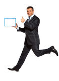 One man running jumping holding whiteboard Royalty Free Stock Images