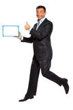 One man running jumping holding whiteboard Stock Photo