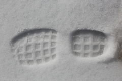 One man's footstep on the fresh friable snow Stock Photos