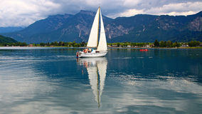 One man sailing on calm lake Royalty Free Stock Photography