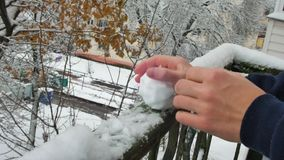 One man sculpt snow in hand stock footage