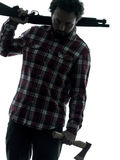 Man serial killer with shotgun silhouette portrait Stock Photography