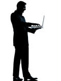 One man silhouette computing computer Royalty Free Stock Photography