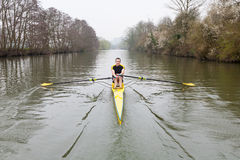 Man rowing on the River Avon. One man in a single scull rowing boat on the river Avon in Bath, UK Royalty Free Stock Photography