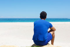 One man sitting alone at the beach Stock Image