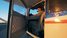 One man sitting in a light airplane`s cockpit, close up. An aviator sits in a cockpit stock footage