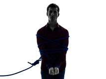 One man trapped catched lasso prisoner silhouette Stock Images