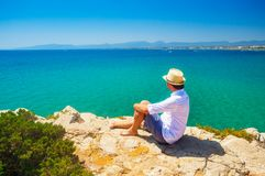 One man on  tropical resort. One man on seaside enjoy sea view. Tourist looking at beautiful bay on tropical resort Stock Photo