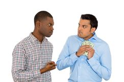 One man trying to steal money from the other Stock Images