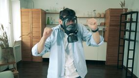 One man wears a respirator and has fun at home during quarantine.