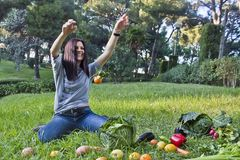 One mandarin levitating. In a park Stock Photo