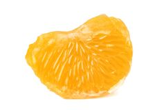 One mandarin section. Slice of peeled tangerine isolated on white background Royalty Free Stock Photo