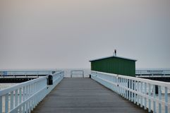Beautiful wooden pier in the Sweden,Malmo. One of many beautiful wooden piers with green fishing hut in the Sweden, Malmo Royalty Free Stock Photos