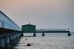 Beautiful wooden pier in the Sweden,Malmo. One of many beautiful wooden piers with green fishing hut in the Sweden, Malmo Royalty Free Stock Image
