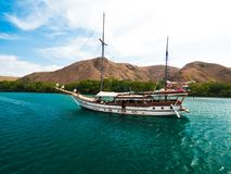 Traditional day boat moored in Komodo National Park. One of the many day boats that divers can use to access Komodo National Park from Flores. Moored in front of Stock Photography