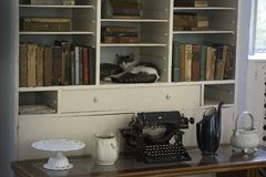 One of Ernest Hemingway`s six toe cats sleeping in his bookcase in his writing room. One of the many Ernest Hemingway`s six toe cats sleeping in his bookcase Stock Photos