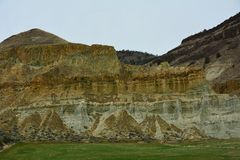 Rock Strata in Central Oregon. This is one of many examples of rock strata found in Central Oregon. It is bordering a farm Royalty Free Stock Photos