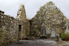 One of many old,historic cemeteries that dot the countryside, Ireland,October,2014. Old stone walls of ancient buildings with gravestones, in just one of many Stock Image