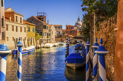 One of many small canals in Venice, Italy. Where some of the parked boats have easy access and others don't Royalty Free Stock Photo