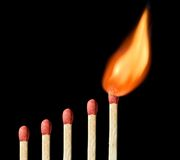 One matchstick on fire Stock Photos