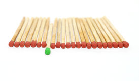 One matchstick standing out from other Royalty Free Stock Photography