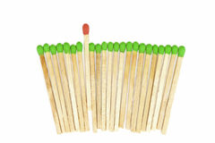 One matchstick standing out from other Stock Photos