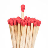 One matchstick standing over from the group, Stock Photo
