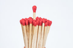 One matchstick standing over from the group, Royalty Free Stock Photos