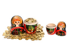 One Matryoshka full of coins and another empty. Two Matryoshkas. One Matryoshka is full of coins and another is empty at white background Stock Photos