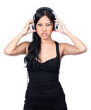 One mean DJ. A young girl listening to music making a mean face Royalty Free Stock Photo