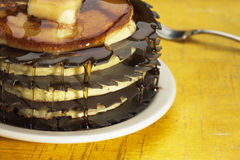 One mean stack. Stack of pancakes interlaced with circular sawblades Royalty Free Stock Photography