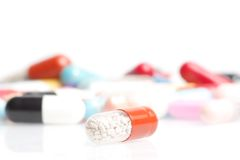 One medical pill in front of a lot of medical pills in laboratory Stock Photography