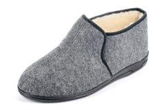 One men's fleece slipper on white background. One grey men's fleece slipper on white background Stock Image