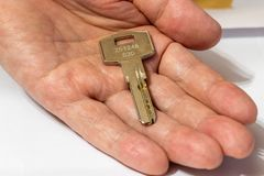 One metal key lies on the palm of your hand.  royalty free stock photography